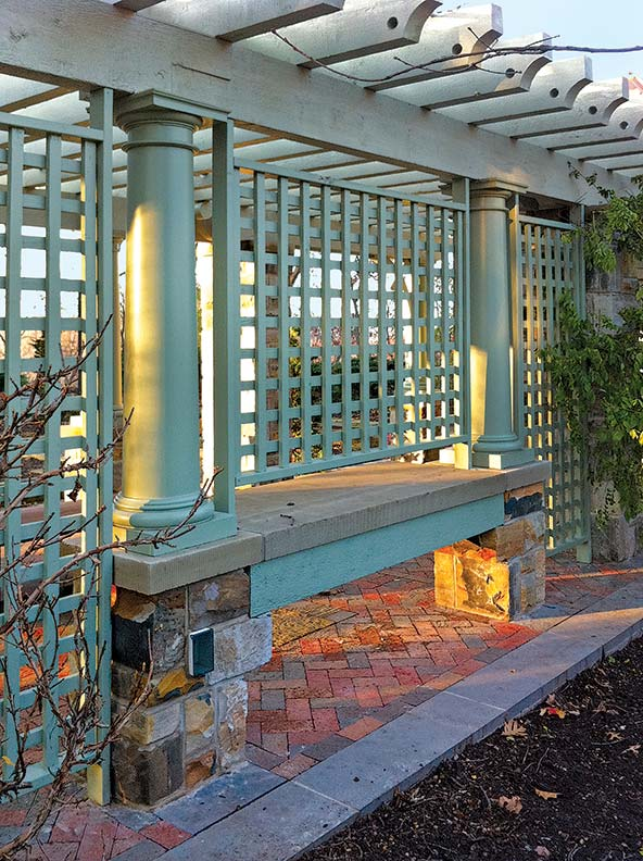 A pergola and trellis offer architectural structure to the garden.