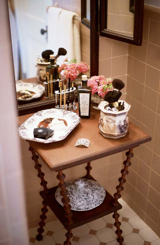 Sandy collects spool furniture with a passion. In the bathroom, a table is used as a vanity.