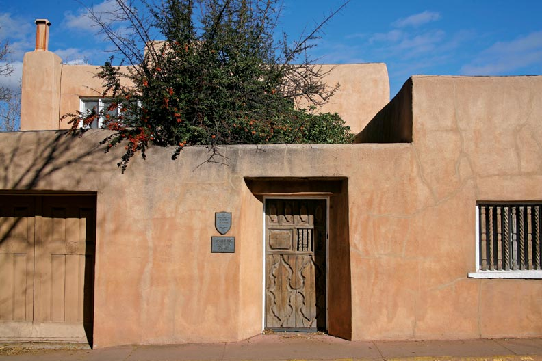Strong geometric forms with a typical carved-wood door mark the 1923 Edward Brooks House.