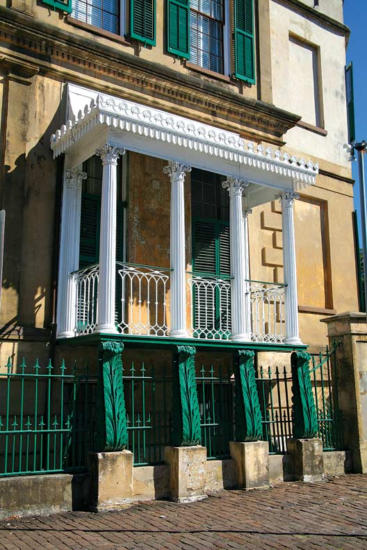 The dramatic Regency side porch of the Owens-Thomas House, 1818, displays a a wealth of neoclassical detail that's raised on four cast-iron console-like posts imported from England.