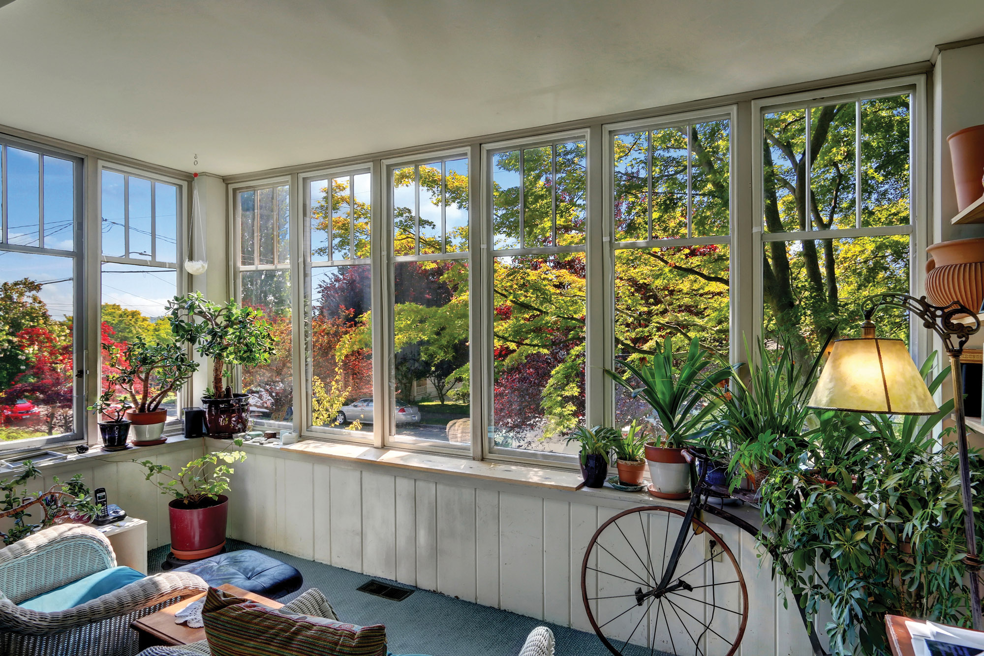 Thermal compression windows, like these from Indow, can extend the seasonal use of a room that has many windows.