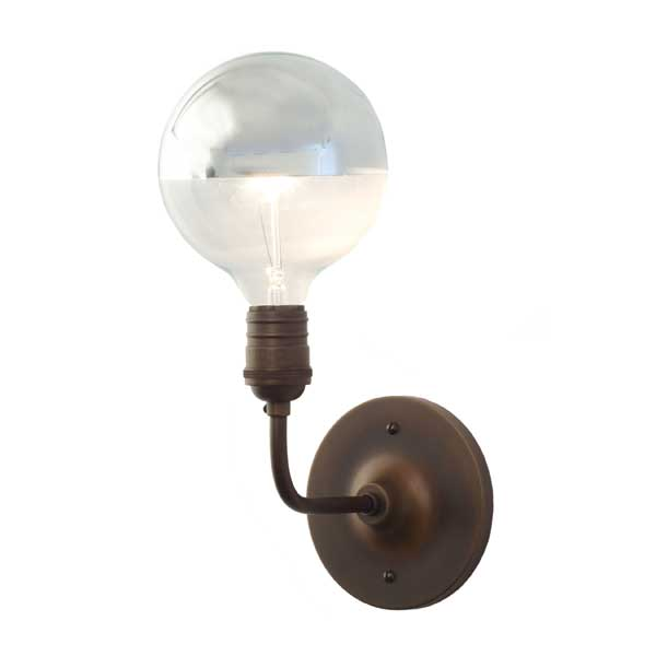 Schoolhouse Electric's Satellite sconce features a silvered bulb.
