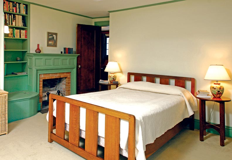 Mrs. Scranton requested the bedroom fireplace and built-ins. The bed and side tables are by Gustav Stickley.