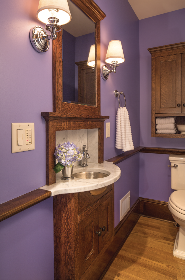 Purple bath with inlaid sink.