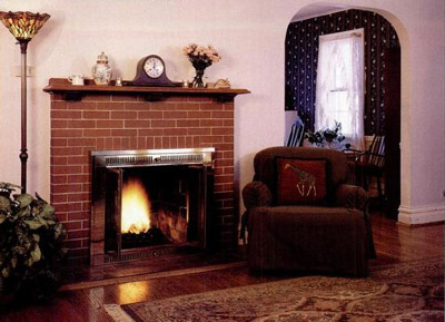 The living room of the Cedars features an English colonial fireplace and plastered arches.
