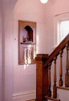 This telephone stand located on the stair landing was a convenient standard feature in the Cedars house plan.
