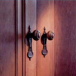"""The """"La Tosca"""" hardware design was a standard feature in the 1930s Cedar. All lock sets were finished in """"lemon"""" brass or sanded """"old"""" brass."""