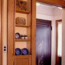 The Sears catalog offered such extras as built-in china shelving and ironing board that serves as a spice rack today.