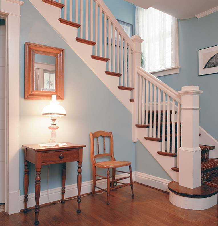 Staircases were often the visual centerpiece of the two-story models, and their design reflected the era in which the houses were constructed, varying from rectilinear Arts & Crafts in the 1910, such as in the Woodland (shown here), to Spanish and Old English in the 1920s to Colonial or Early American in the 1930s.