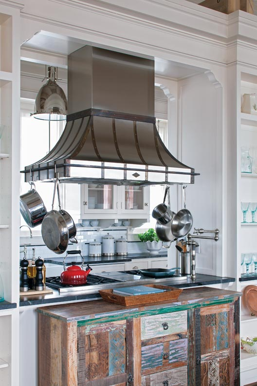 Braulio Casas created an efficient open-plan kitchen with traditional detailing in Seaside, Florida.