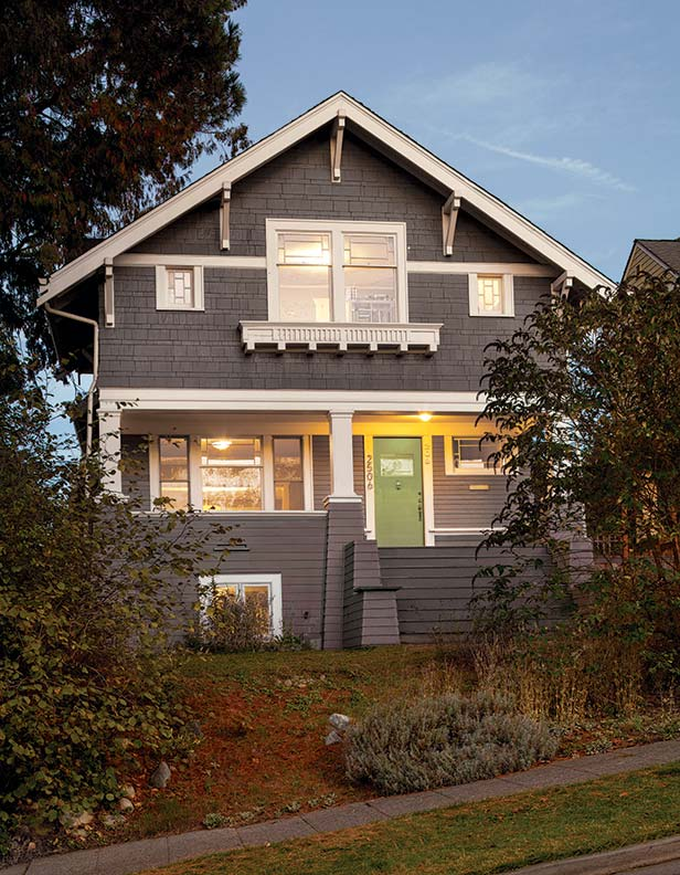 Settled in its new home on a steep Seattle hillside, the 1906 Craftsman looks like it's always been there.