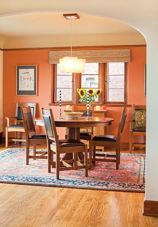 Arts & Crafts furniture includes the reissued Stickley oak pedestal table and chairs. In its simplicity, the modern Artemide Logico Suspension triple chandelier is a good fit.