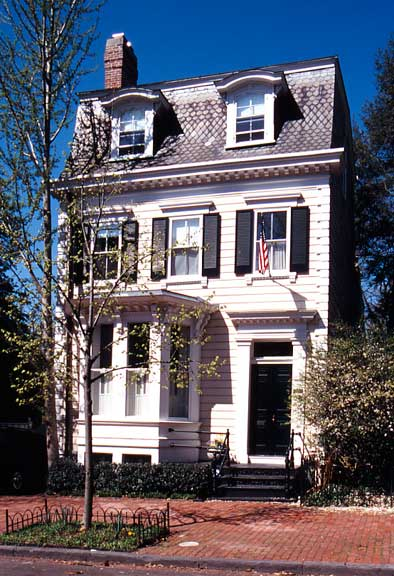 This modest-frame Second Empire house in the Georgetown Historic District of Washington, D.C. carries the style in simplified form. The bay window, door, frontispiece, corner quoins, and modillion cornice provide a comfortable degree of ornament for a smaller residence.