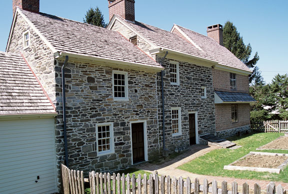 Additions are ancient notions, and traditional patterns make excellent models for old houses. Here, a 1696 brick house was expanded to the middle in the 18th century, and again in the 1970s, each time subordinating the roof line.