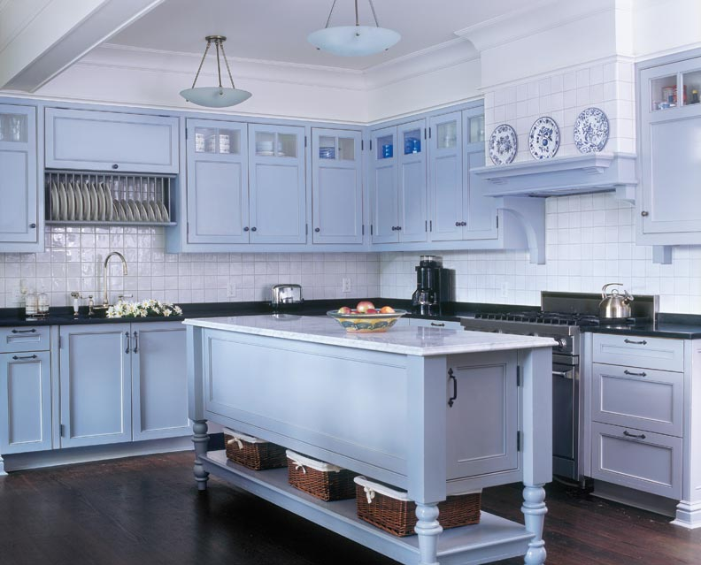 The kitchen designed by McKee Patterson has simple Shaker style cabinets painted a soft gray—the color of 2014.