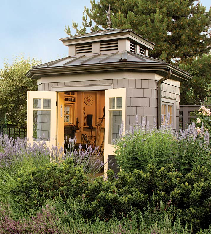 Shingle siding lends this octagon-shaped garden shed an Arts & Crafts aesthetic.