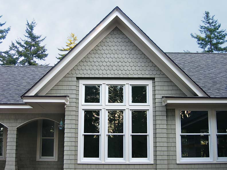 Decorator panels in two shapes—round and square—were used together to form the exterior cladding of this house.