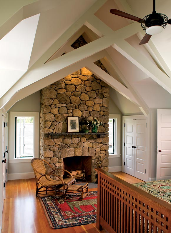 Crisscrossed support beams support cathedral ceilings in the vaulted master bedroom.