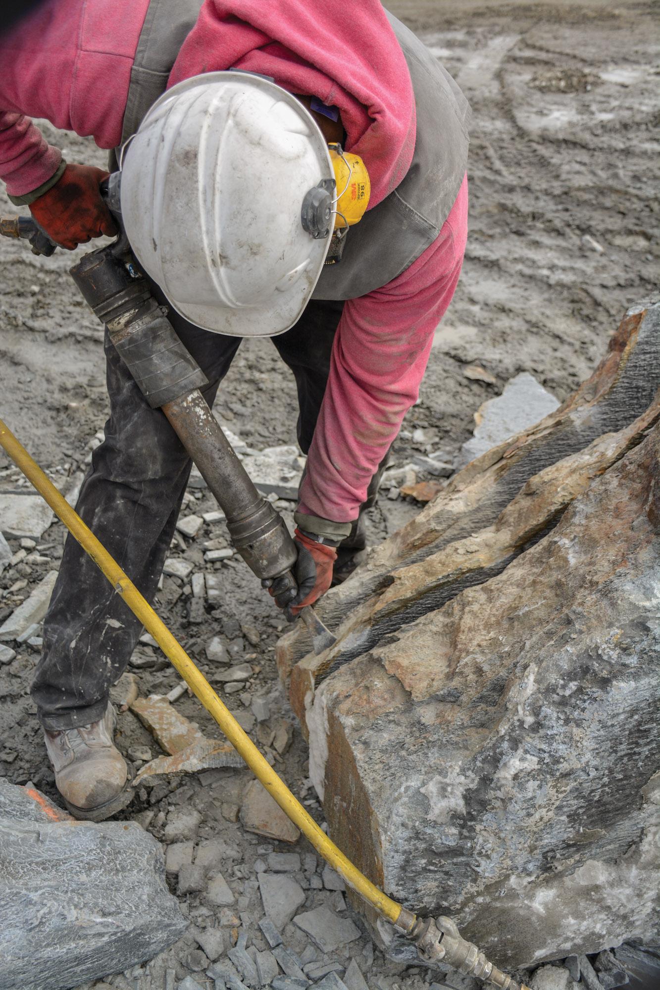pneumatic splitting hammer on stone