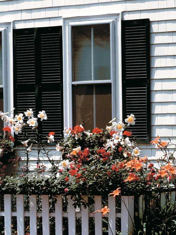 Historically, shutters were always fastened to the window casing—never to the wall of the house.