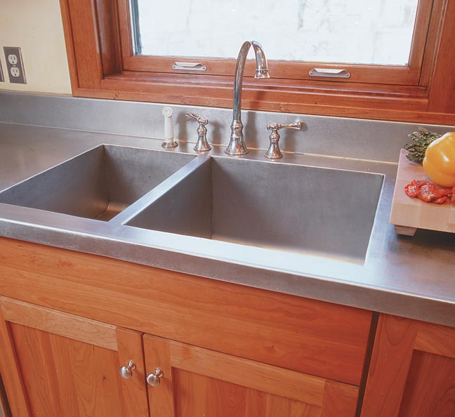 Designer Gary Crowley was going for a '20s feel when he chose a stainless steel sink for this kitchen. Monel, a white metal no longer common, might have been a more likely choice of that era.