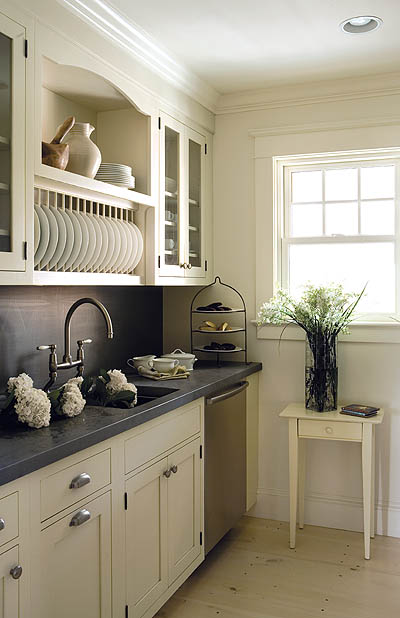With its own sink, dishwasher, and under-counter refrigerator, the butler's pantry acts as a functional preparation space.