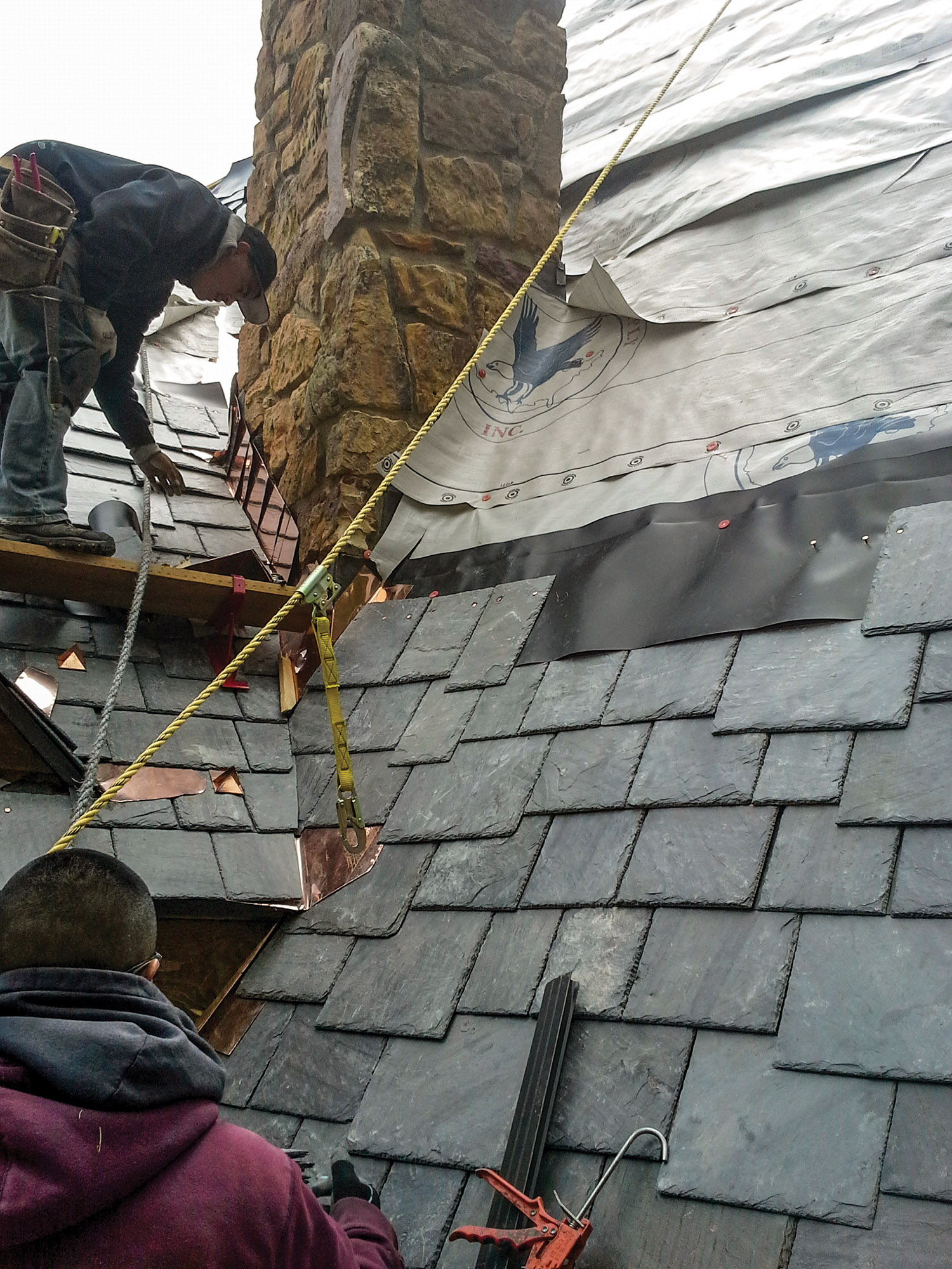A long-lived membrane better know as landfill liner lies between courses of slates, reducing the amount of head lap required. As a result, less slate is needed to cover the roof, reducing weight and bringing significant cost savings to the owner.