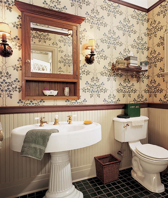 For a powder room in an Arts & Crafts house, the pedestal sink and wainscot copy those in an upstairs bath.