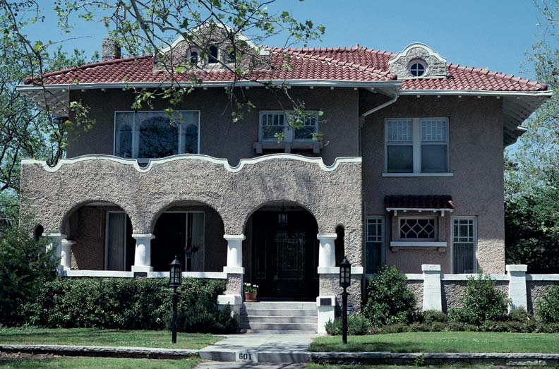 The 1909 Gerson House in Oklahoma City, with its arcaded porch, stuccoed walls, barrel-tile roof, and curved dormers, is a good early example of the Mission Revival style.