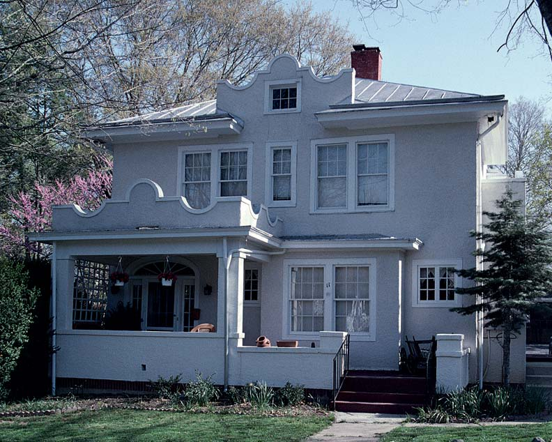 """This refined example of the Mission Revival is in Lexington, Virginia. It is notable for the """"shaped,"""" or curved, gables over the porch and dormer."""