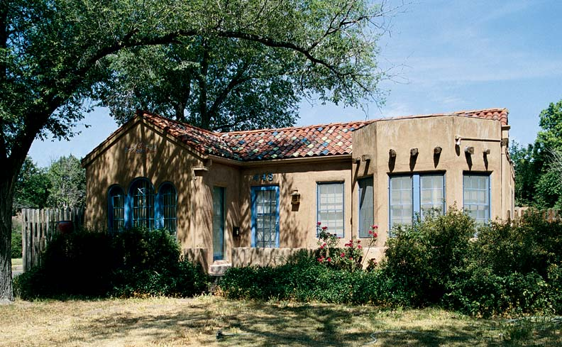 A traditional Spanish house in Albuquerque sports an unusual Pueblo-style bay window, replete with vigas—projecting round beams used in traditional Pueblo work.