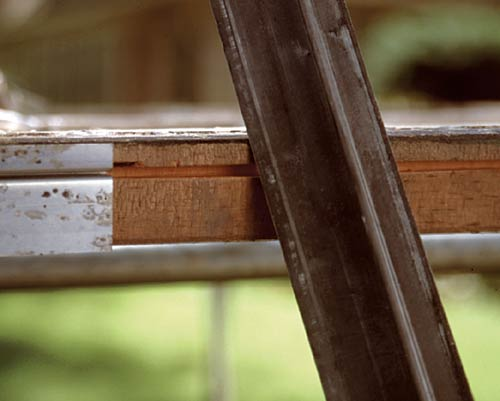 """The raised """"track"""" on a flanged weatherstrip slides in a groove on the sash edge, creating an integral seal. Locate the proper position for the groove by laying the strip upside-down on the sash."""
