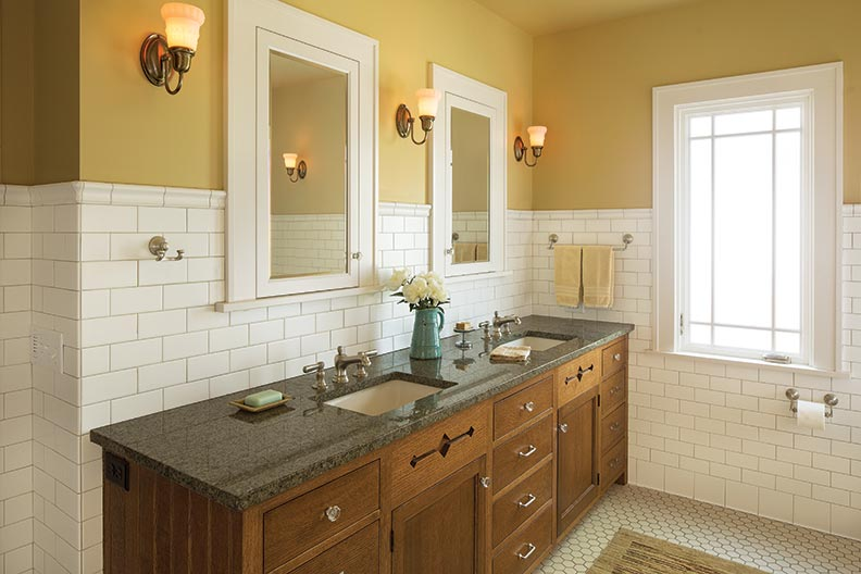 in the master bathroom, True-to-period medicine cabinets were custom-designed. Glass knobs add a touch of glamour.