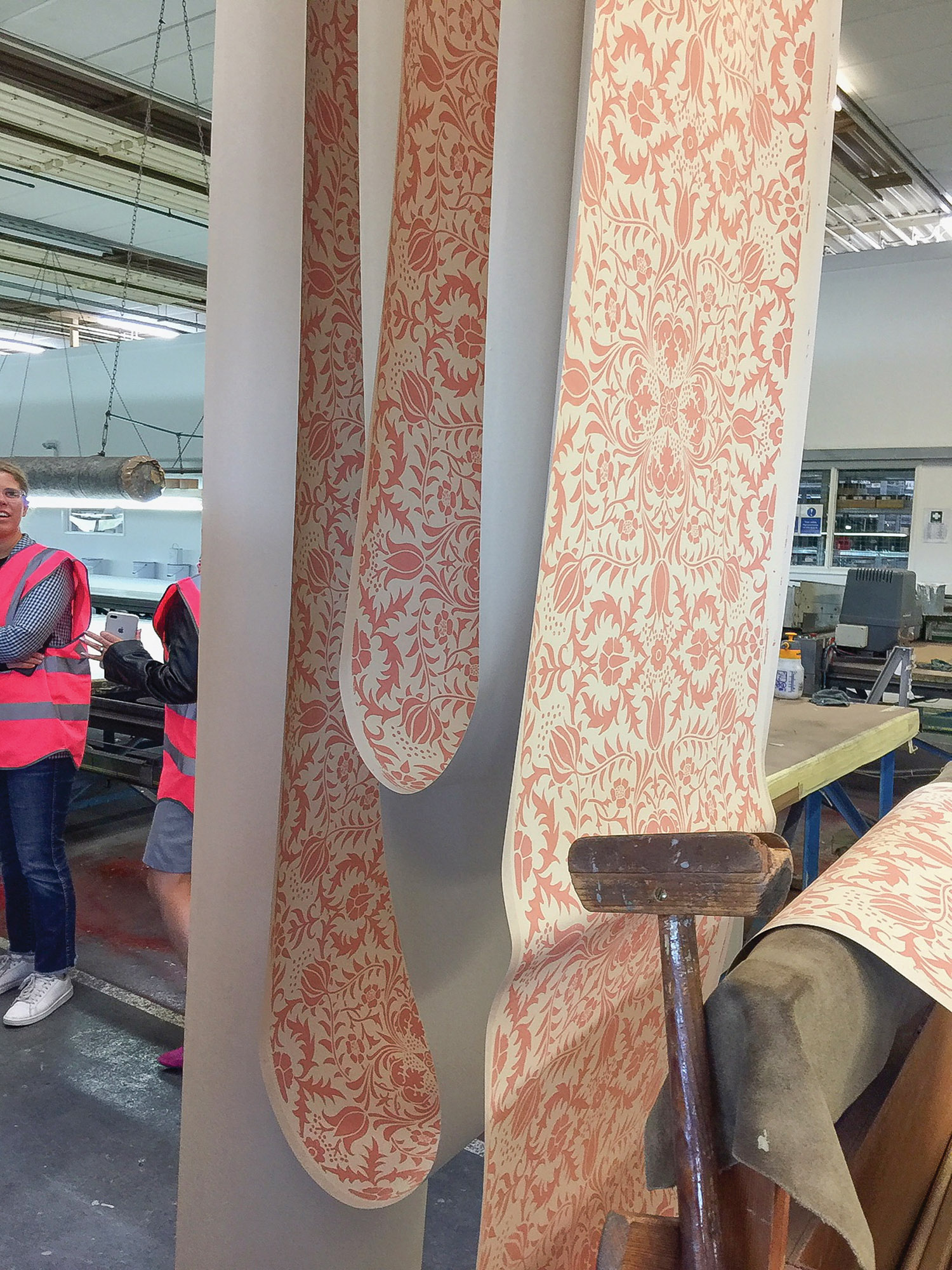 A hand-blocked version of an early William Morris paper is festooned to dry at the Anstey factory.