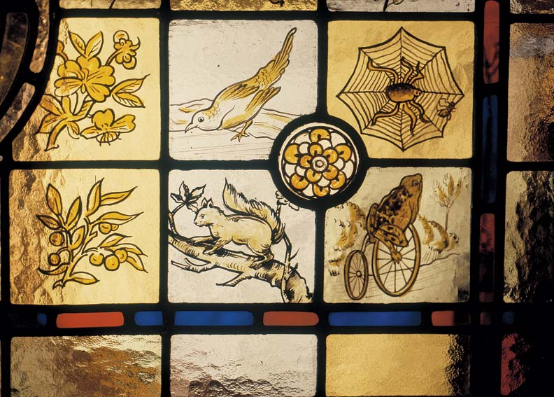 A fanciful painted glass window bears themes from nature.