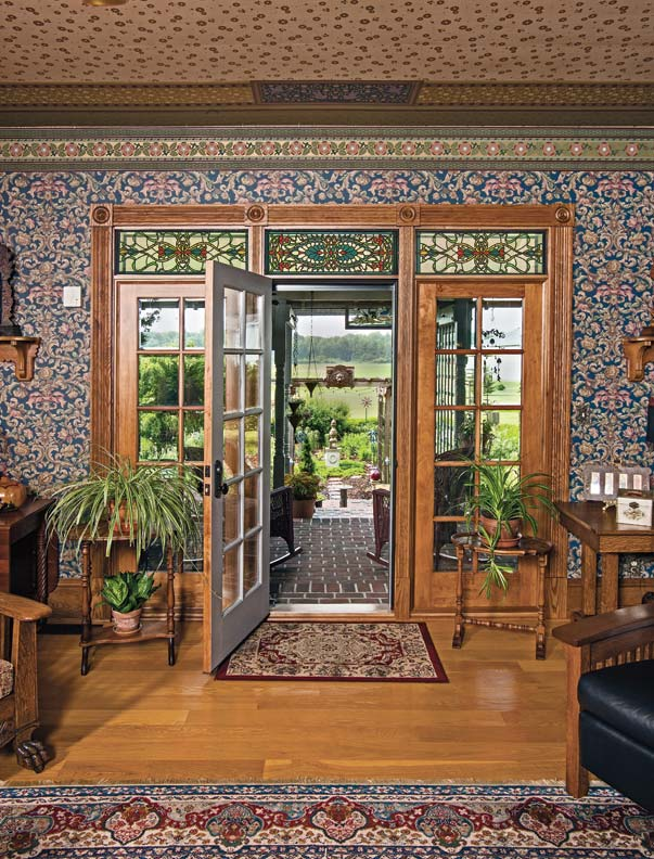 Stained-glass transoms by Pete Bullard of Brown County Artisans add height to French doors.
