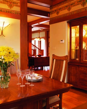 Stenciled walls and a built-in china cabinet dress the dining room.