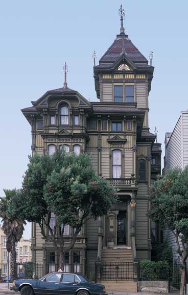 "San Francisco's famous Westerfield House (1889) is a good example of how a tower and repeated vertical stickwork enchance the verticality of an already tall building. The sawtooth board-ends on the olive-colored, second-story ""frieze"" are a classic Eastlake motif."