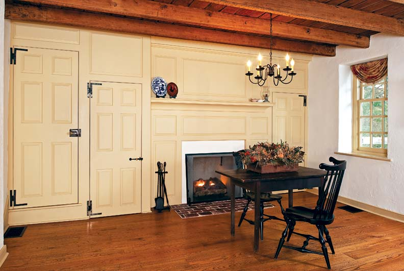 The Dolans painted the living room's new fireplace surrounds in historic colonial-era colors.