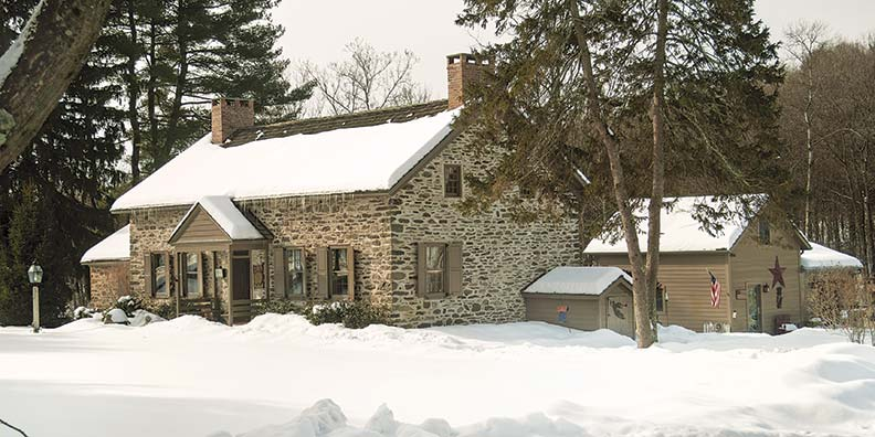 The stone house is typical of a late 18th-century Hudson Valley vernacular that combines Dutch and English influences. A small wood-frame addition housed a former summer kitchen; a large ell was added in later years.