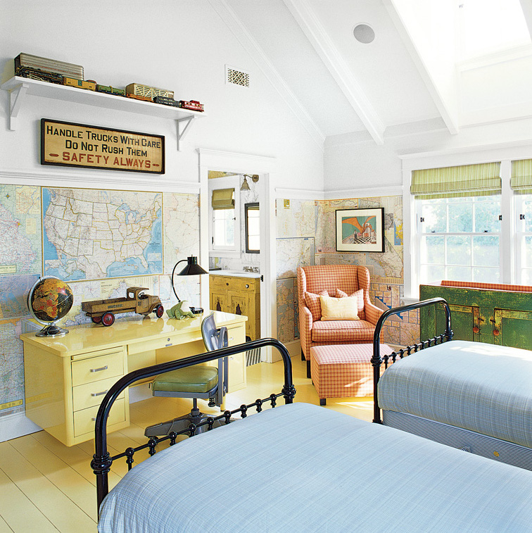 In a child's room, the walls below the picture rail are completely papered in maps. (Photo: Tim Street–Porter)