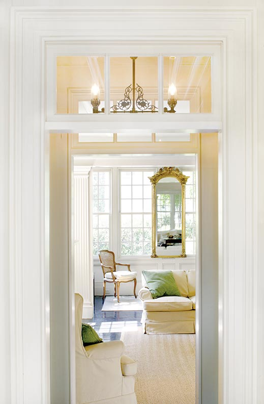 Well-placed mirrors help reflect light in the living room.