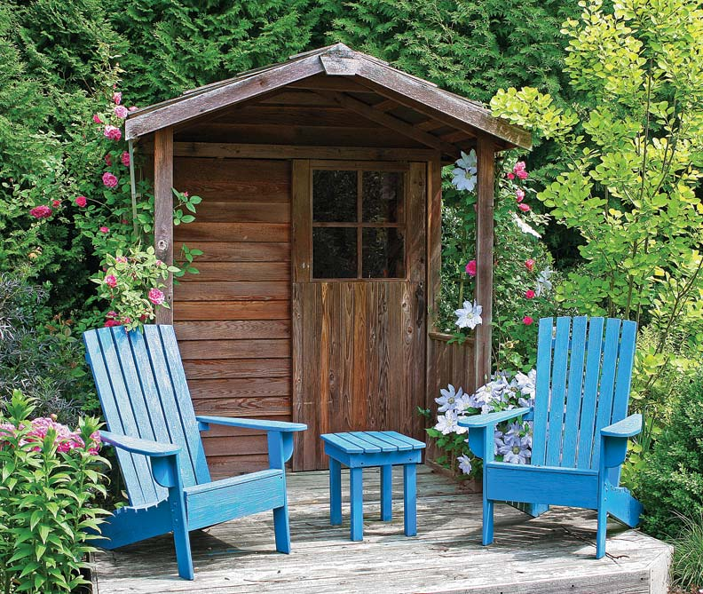 Michael Weishan added this sweet little shed to his own garden and built a small deck to sit and drink in his work.