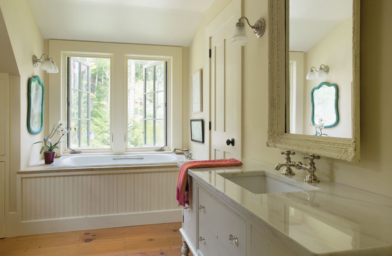 Sandra Vitzthum designed this bath for a family in Vermont. The vanity is an old dresser, which Vitzthum transformed.