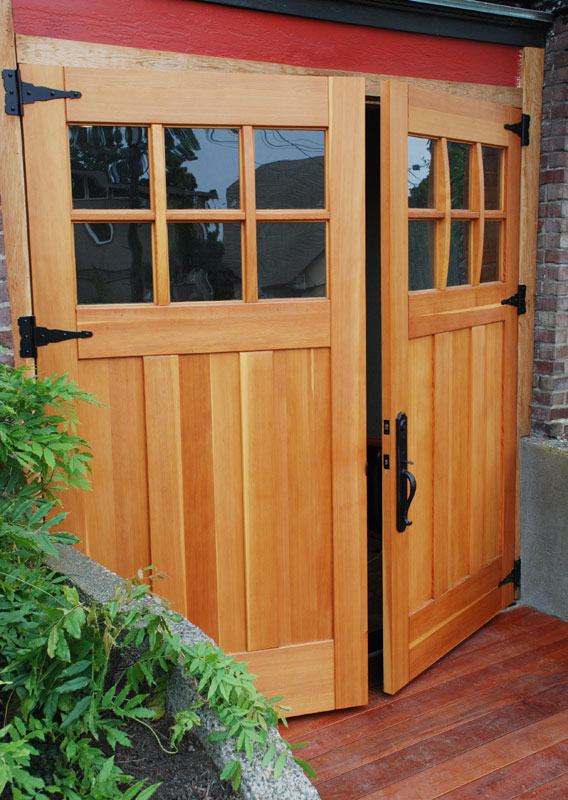 Find garage doors that fit your home s style restoration for Real carriage hardware