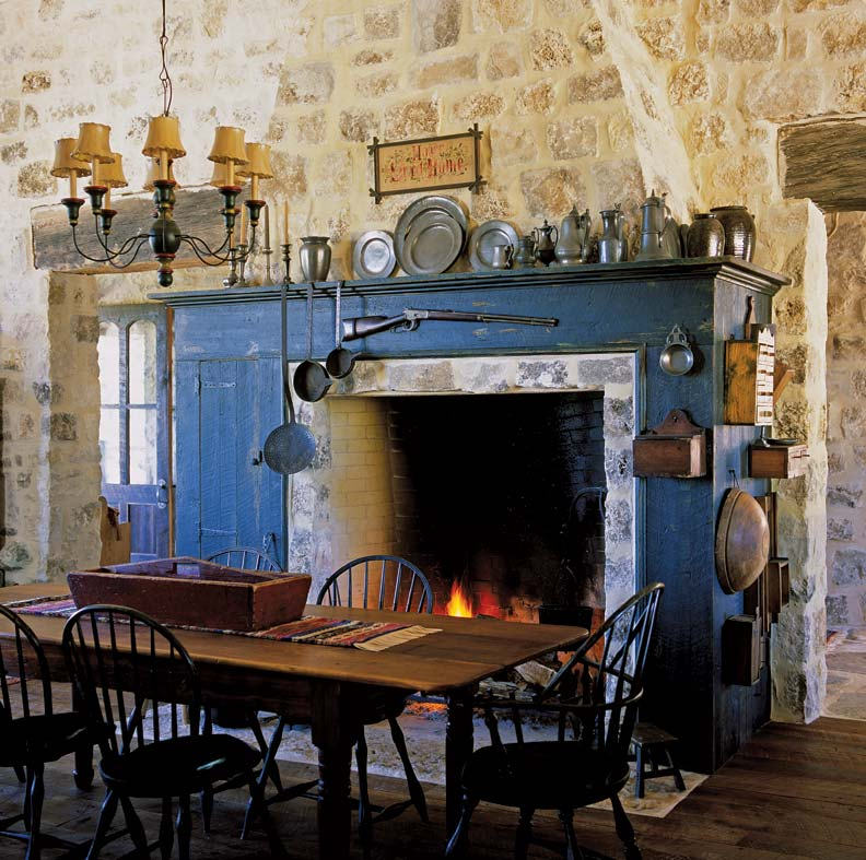 Period details, such as an open hearth and stone walls, offer patina to this Texas kitchen inspired by the past.
