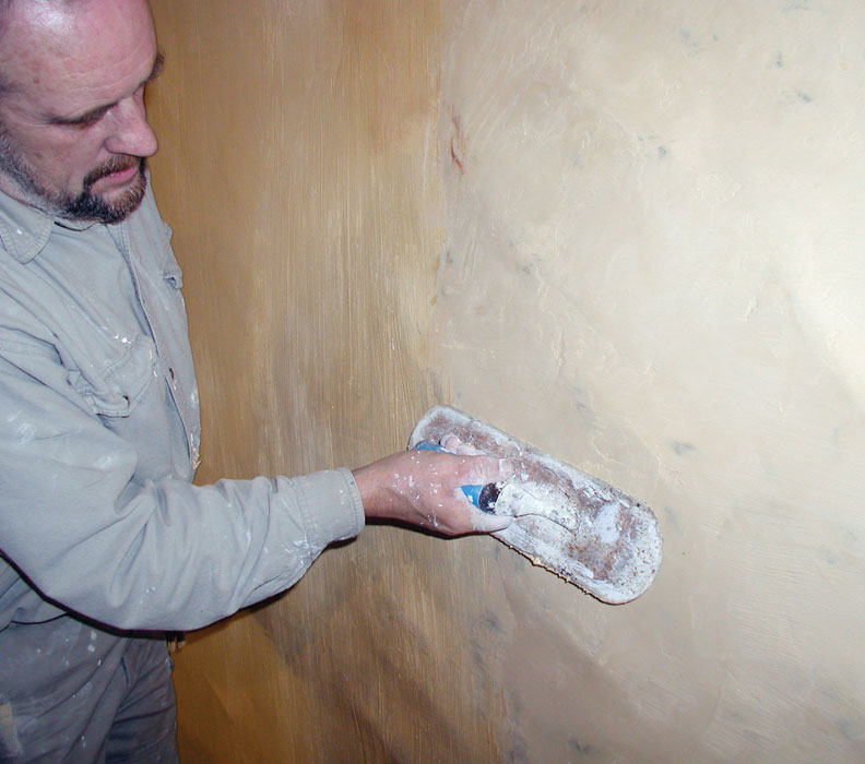 Use a wood or magnesium float to work a newly plastered surface flat and true. These tools won't bring water to the surface like a steel trowel, which can rob it from the interface of base and new plaster.