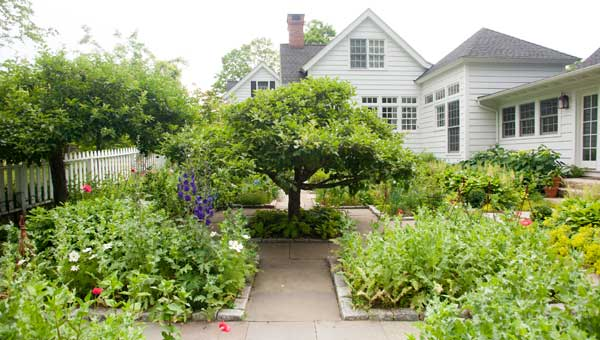The 1850 house, with multiple additions, has gardens on every side.