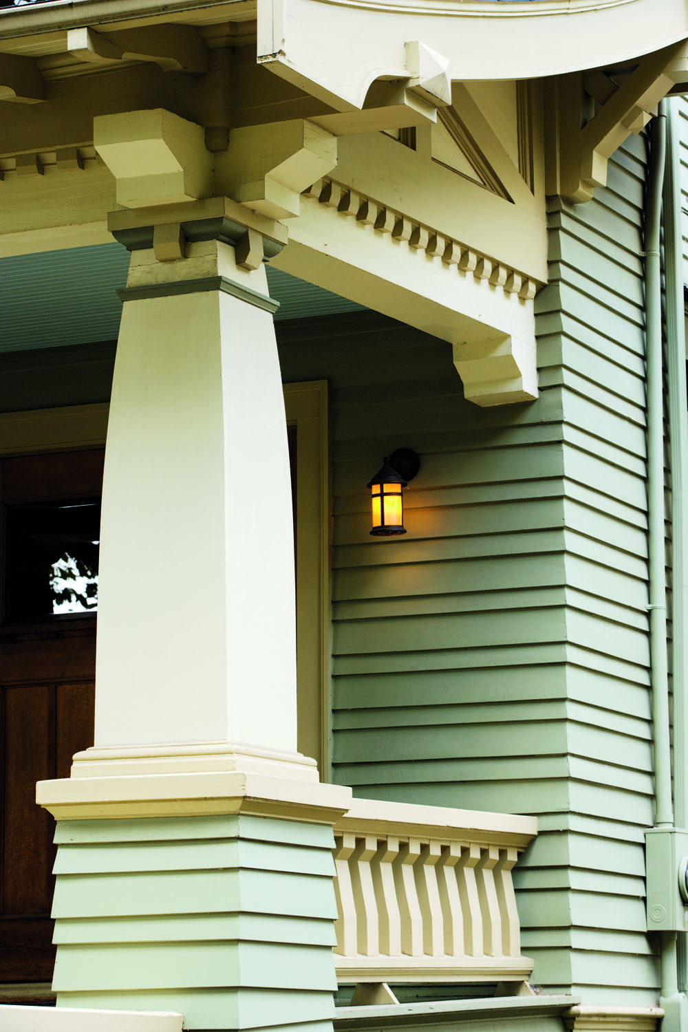 The 1911 exterior is marvelously detailed, with exaggerated columns on piers, leaded and stained glass, brackets—and a great color scheme.