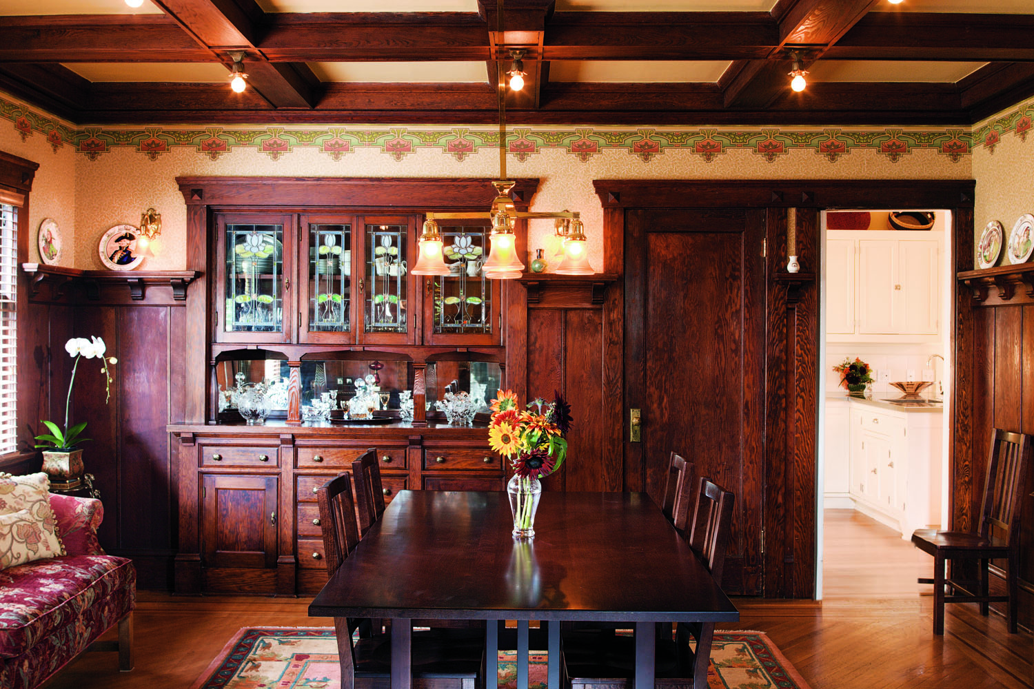 The 1911 house was built with a wealth of detail: Douglas fir woodwork, stained and leaded glass, picture and plate rails. Even the ceilings— box-beamed in the dining room, coved in the living room—illustrate the period's quality.